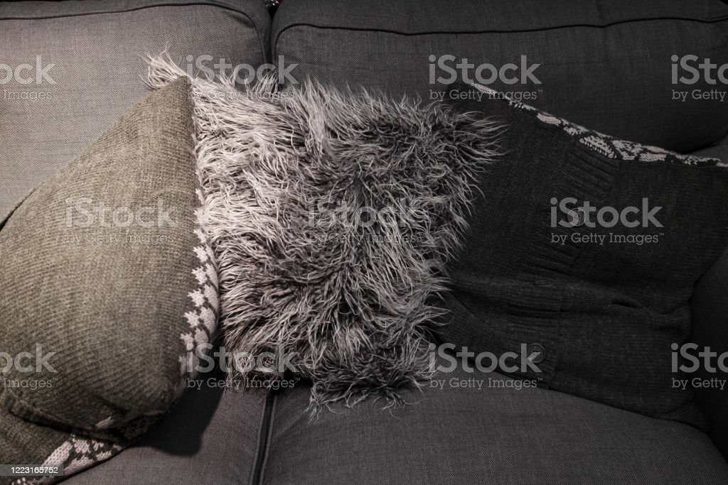 White And Black Long Synthetic Fur Pillow On Grey Sofa Knitted Gray Pillows In The Living Room For Decorating Modern Luxury Style Stock Photo Download Image Now Istock