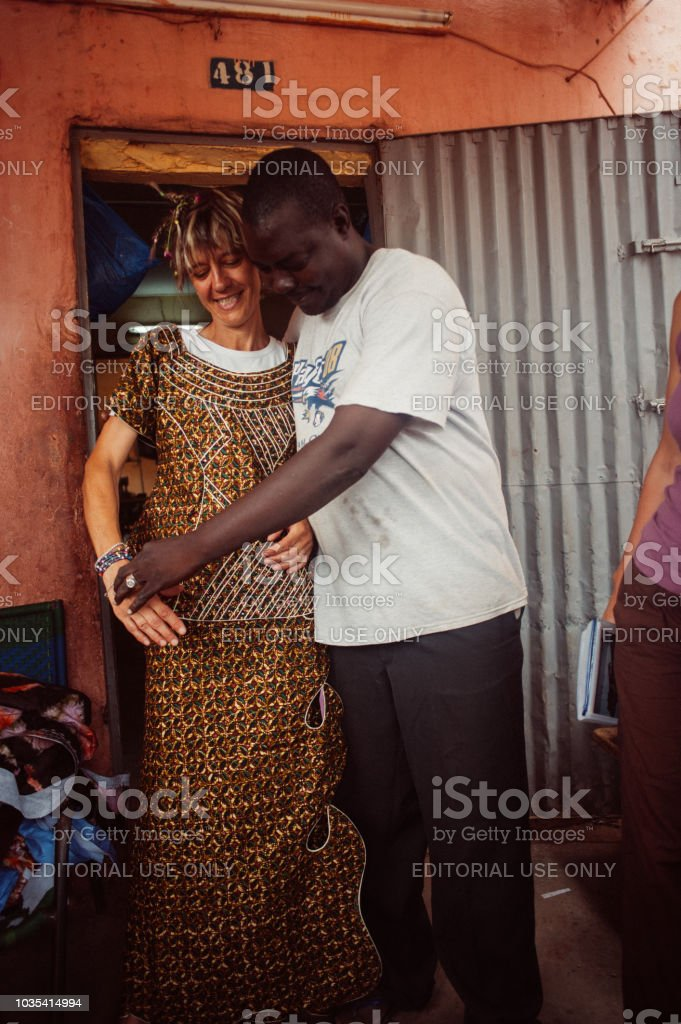 White and black people choosing clothing stock photo