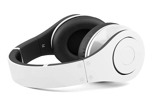 white and black wireless headphones isolated background stock photo