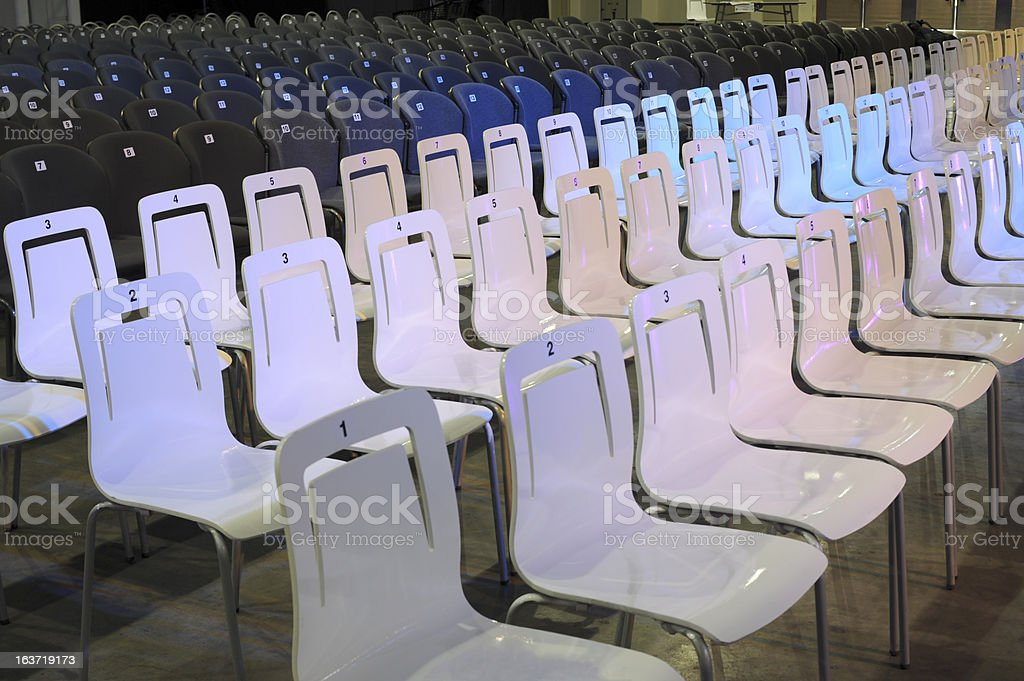 White and blue chairs in rows royalty-free stock photo