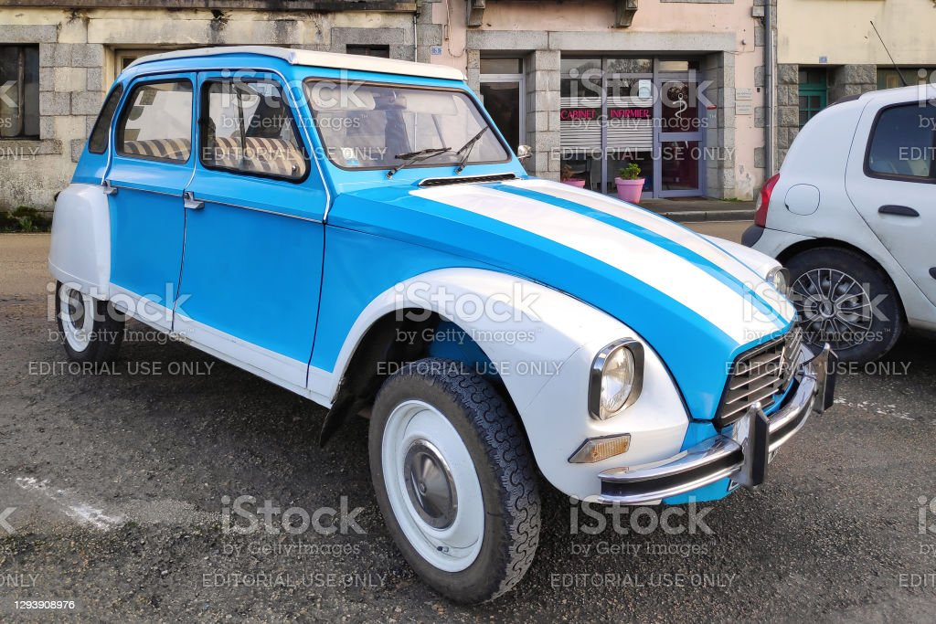 White and blue Citroën 2CV Huelgoat, France - December 19 2020: The Citroën 2CV (French: Deux chevaux) is an economy car introduced at the 1948 Paris Mondial de l'Automobile and manufactured by Citroën. Car Stock Photo