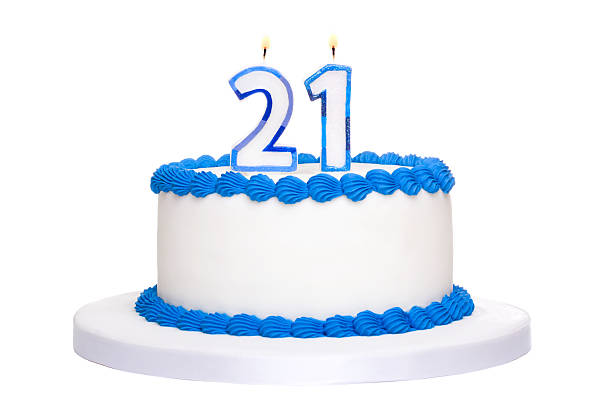 white and blue iced birthday cake with twenty one in candles - number 21 stock photos and pictures