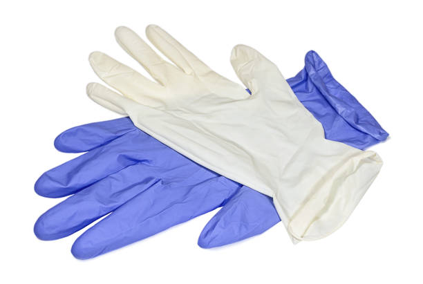 White and blue latex gloves isolated on white background White and light blue latex gloves on white surface. Conception of hygiene, protective and care. surgical glove stock pictures, royalty-free photos & images