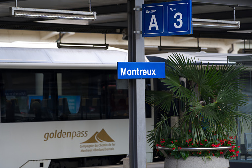 White and blue MOB train at railway station of Montreux.