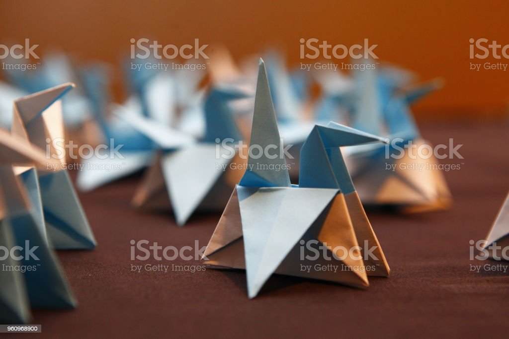 White and Blue Origami Birds stock photo
