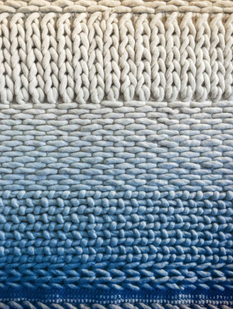 White and blue winter knitted background stock photo