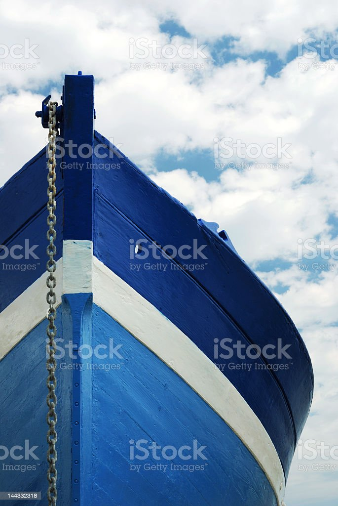 White and blue wooden boat with anchor royalty-free stock photo