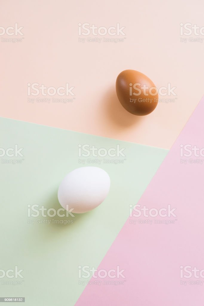 Two eggs on multi color background