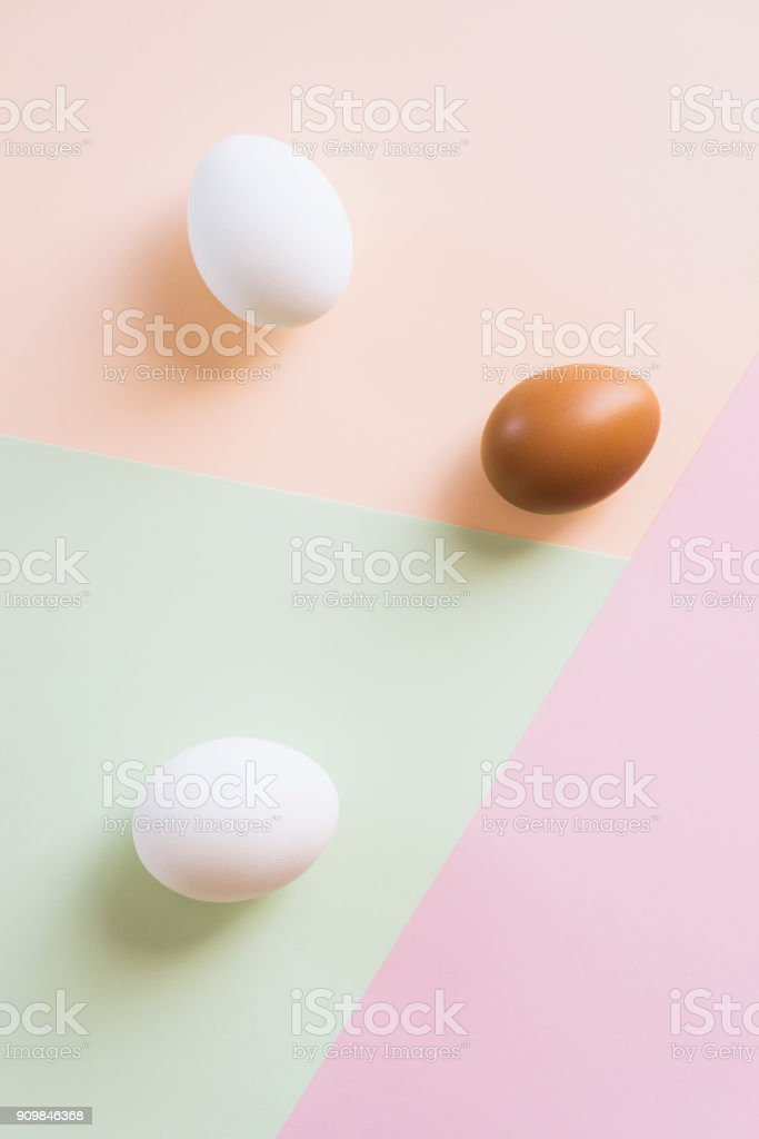 Three eggs on multi color background