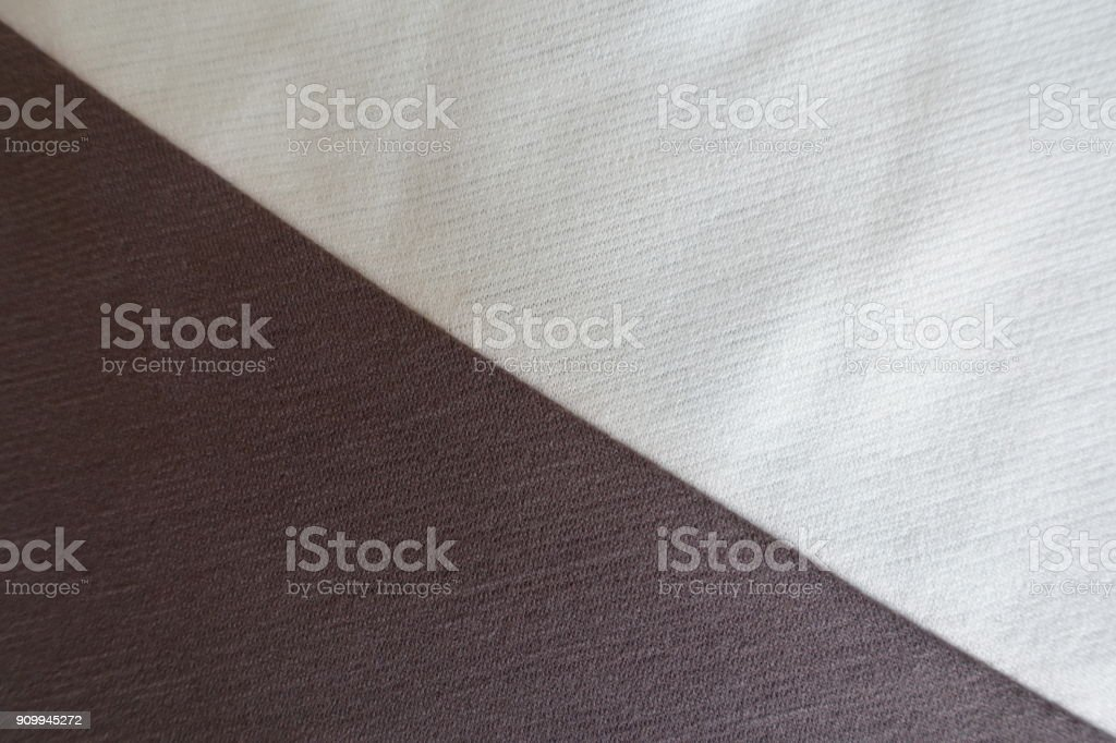 White and brown fabrics sewn together diagonally stock photo