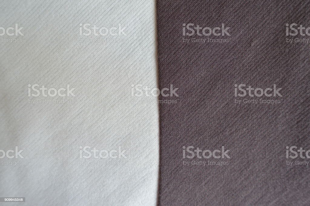White and brown fabrics sewn together vertically stock photo