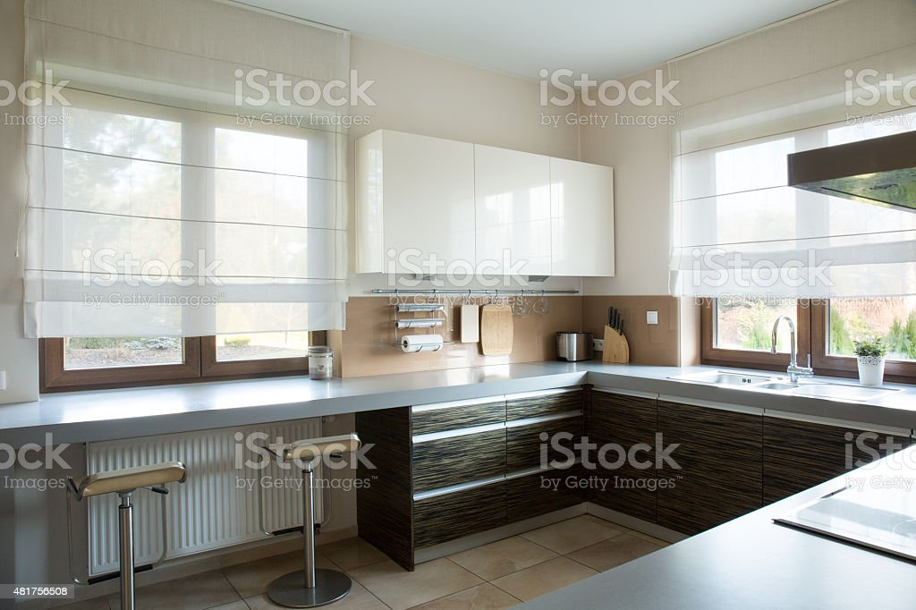 White and brown kitchen interior stock photo