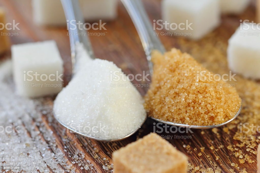 White and brown sugar in spoon stock photo