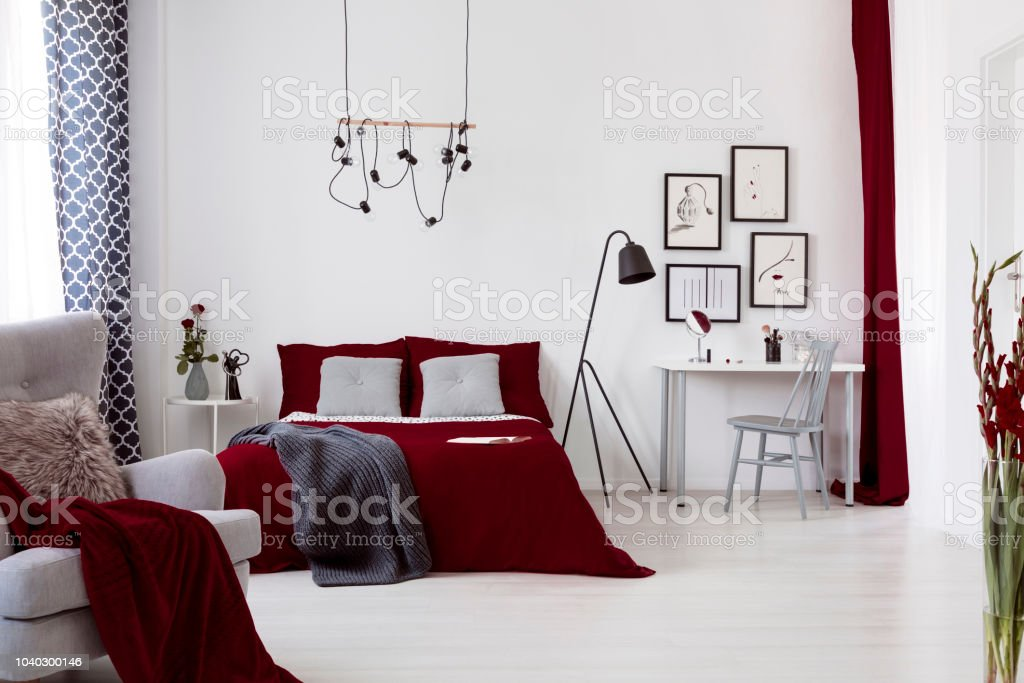 White And Burgundy Contemporary Bedroom Interior With A Bed Dressed In Cotton Linen And Pillows Framed Art Above Small Desk Real Photo Stock Photo Download Image Now Istock