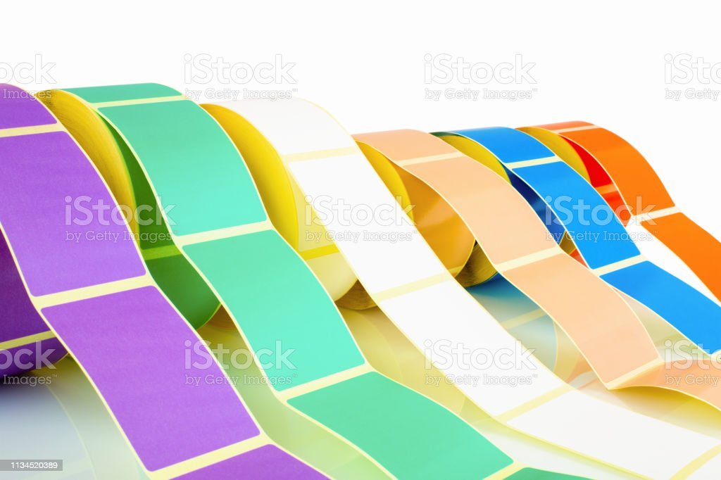 White and colored label rolls isolated on white background with...