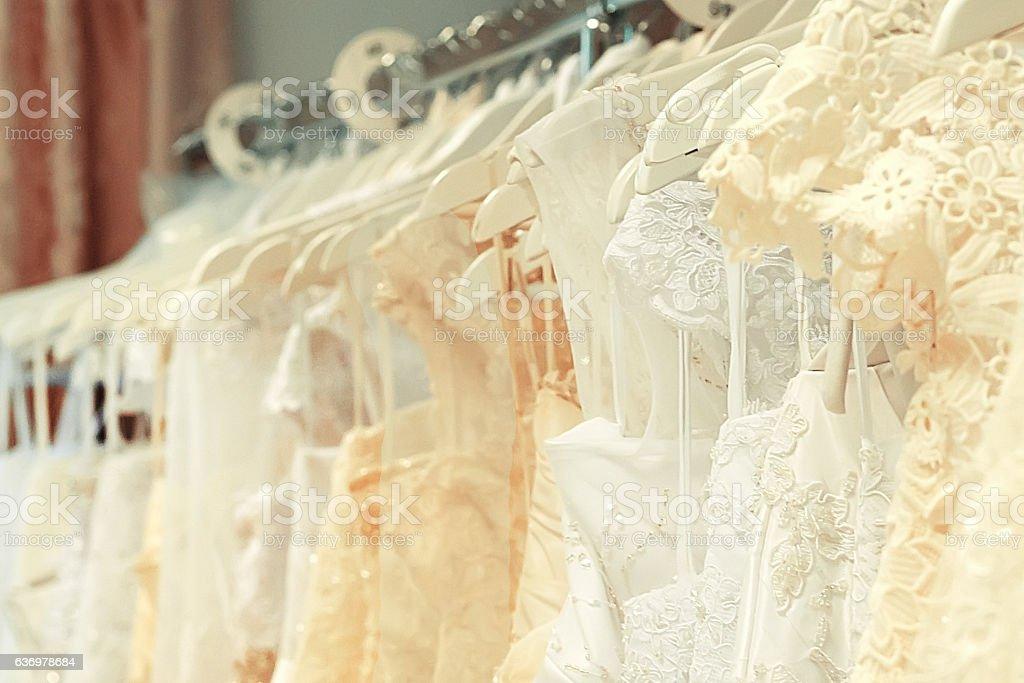 White and cream-colored wedding dresses horizontal stock photo