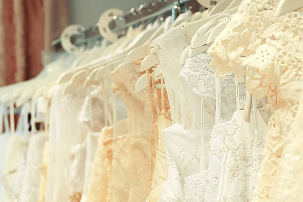 White and cream-colored wedding dresses horizontal stock photo