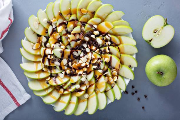 White and dark chocolate chip apple nachos stock photo