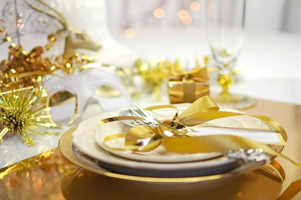 white and gold happy new year elegant table setting - new years day stock pictures, royalty-free photos & images
