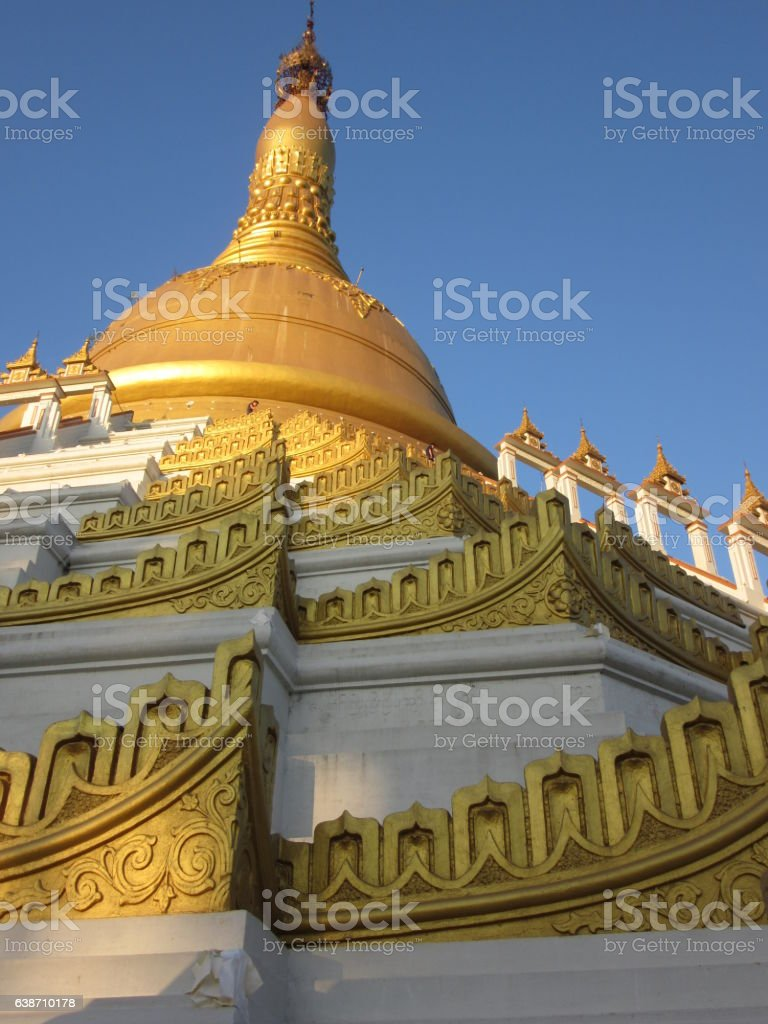 White and Gold Stupa Corners and Arches, Bago, Myanmar stock photo