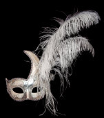 Beautiful white, gold and silver Venetian mask with feathers isolated on black
