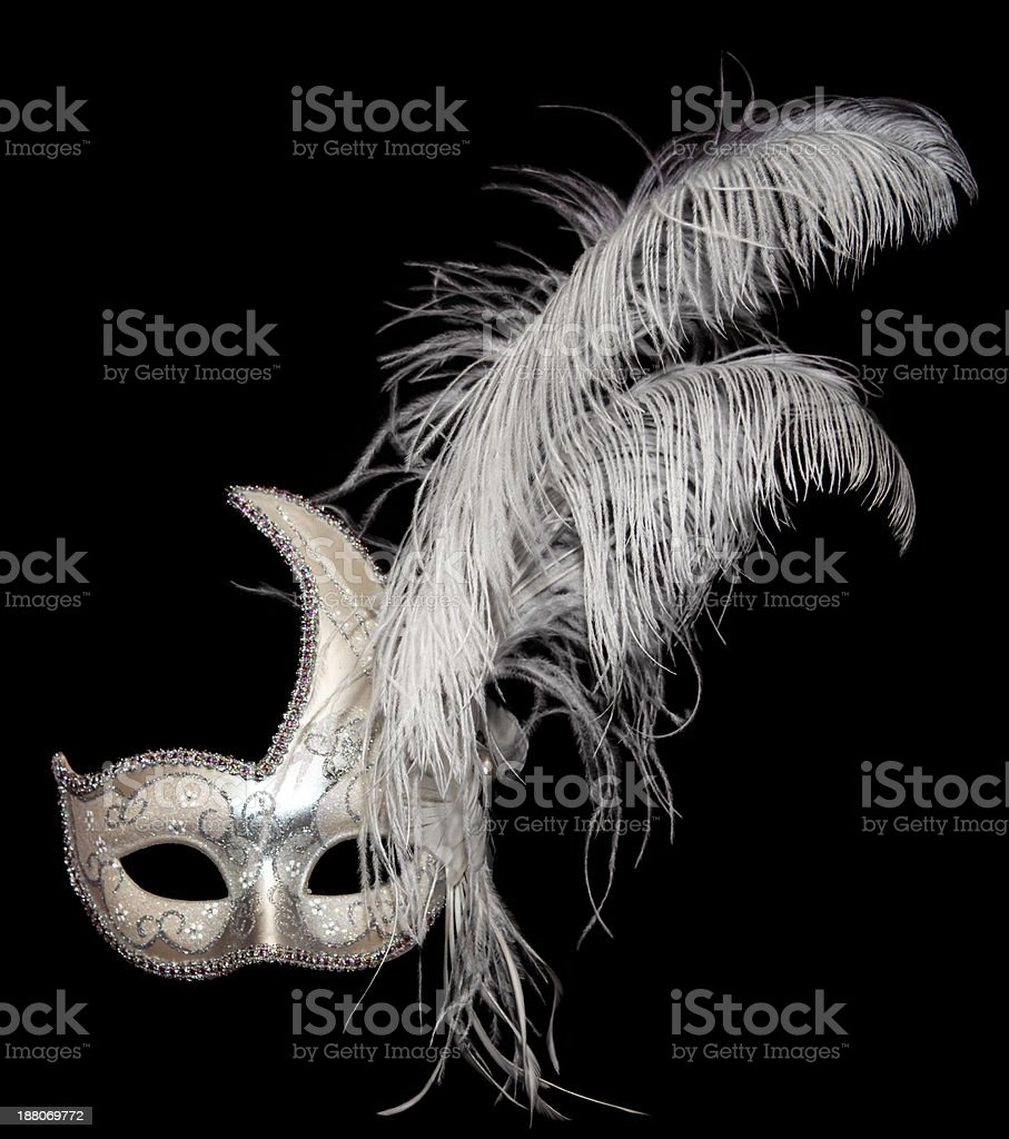 White and gold Venetian mask on black stock photo