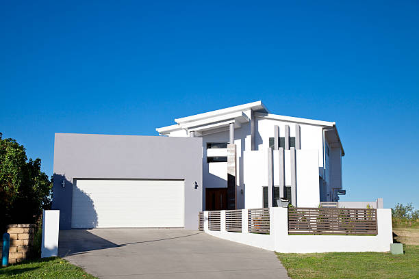 White and gray modern home with large gray garage  stock photo