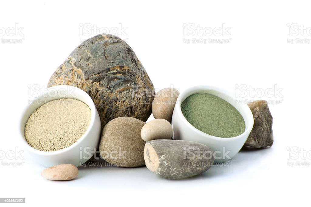 White and green cosmetic clay beside the stones. - Photo
