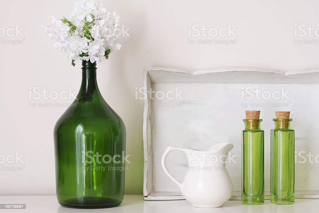 White and green decorative objects on a shelf with white background royalty-free stock photo