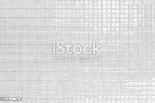 istock White and Grey the tile wall high resolution real photo or brick seamless and texture interior background. 1067008460