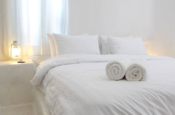white and  luxurious hotel bedroom stock photo