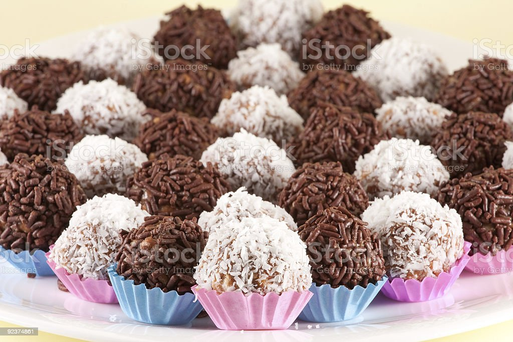 White and milk chocolate balls that are ready to eat royalty-free stock photo
