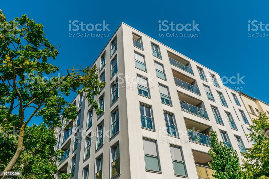 white and modern apartment house at germany stock photo