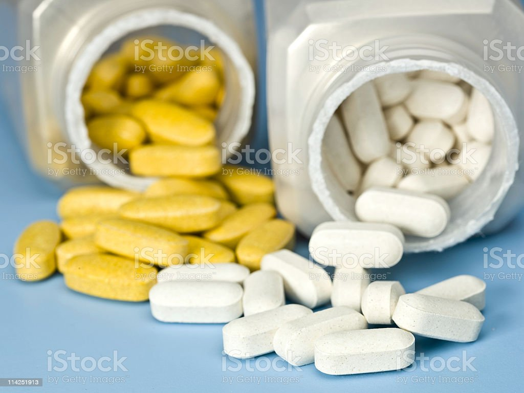 white and orange pills royalty-free stock photo