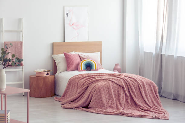 White and pastel pink scandinavian bedroom interior for kid