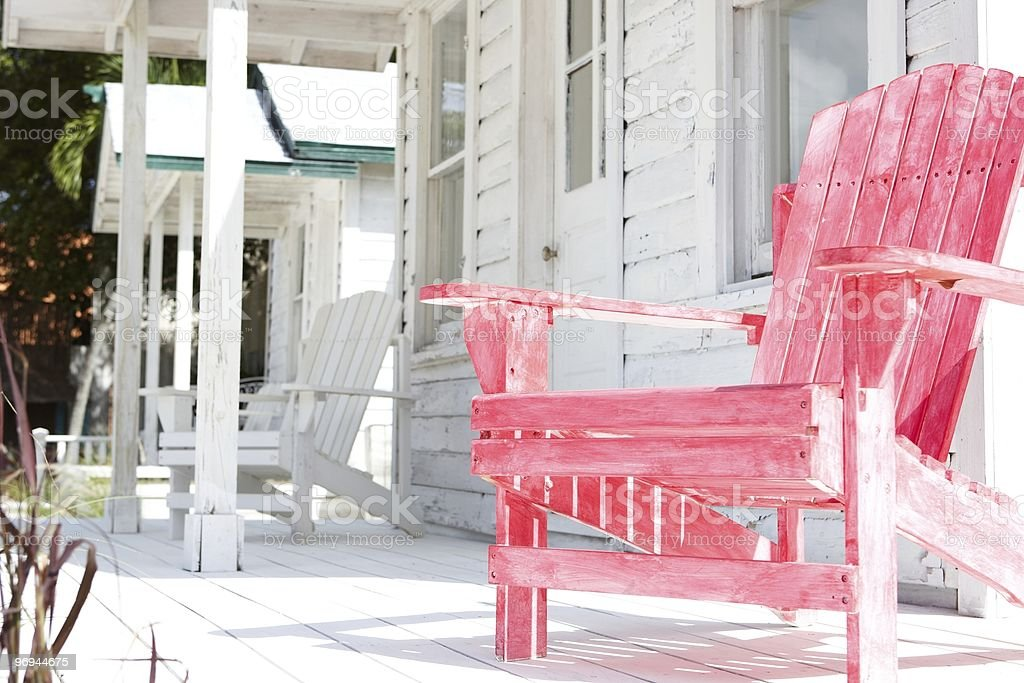 white and pink beachchair in front of a beachhouse royalty-free stock photo
