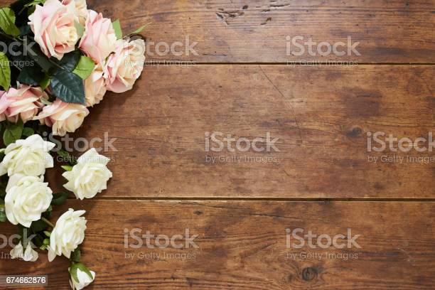 White and pink roses on rustic wood background picture id674662876?b=1&k=6&m=674662876&s=612x612&h=upynftdcadbrn8qsmfnhmf2i 4w65b7ija22df5kvcw=