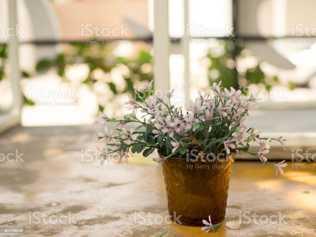 White And Purple Plastic Flowers In Vase Decorative Table Outside