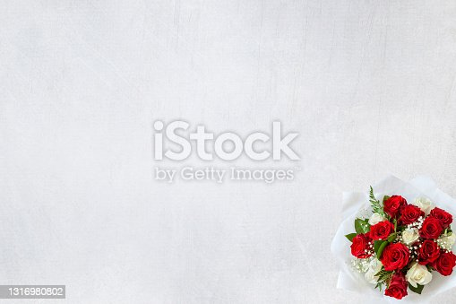 Small white and purple rose bouquet isolated on white vintag background with copy space top view flat lay