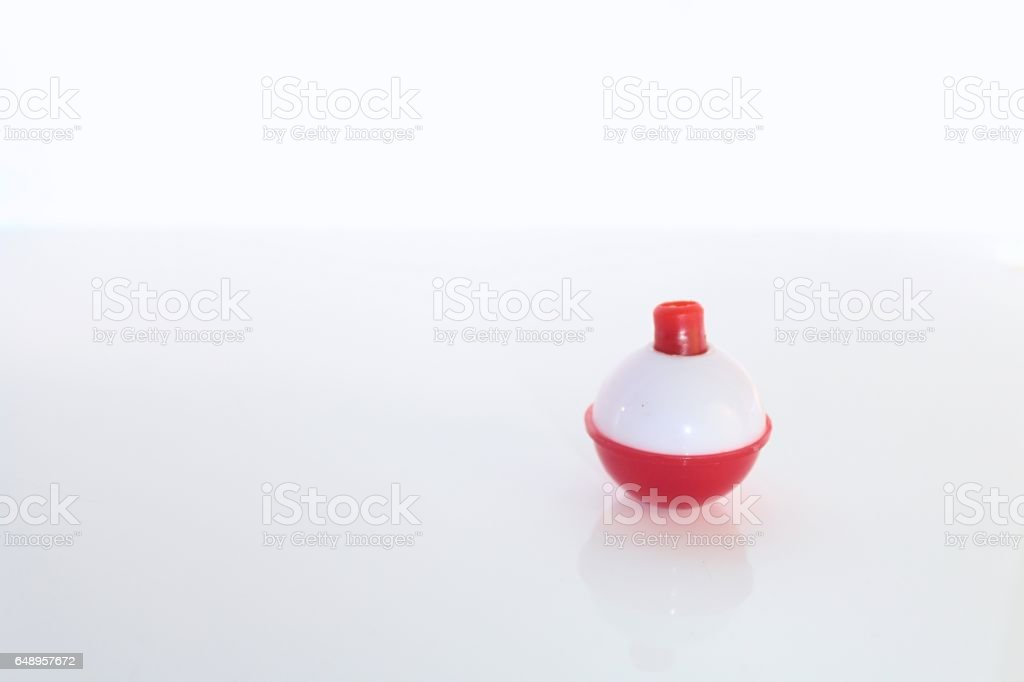 White and Red Bobber for Fishing Isolated stock photo