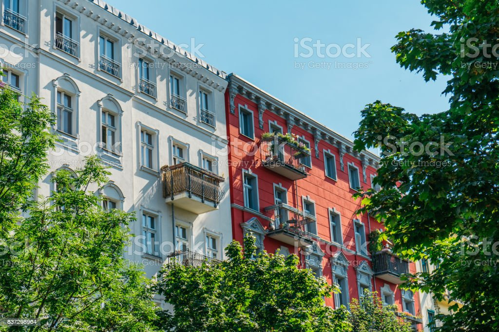 white and red buildings with green tree stock photo