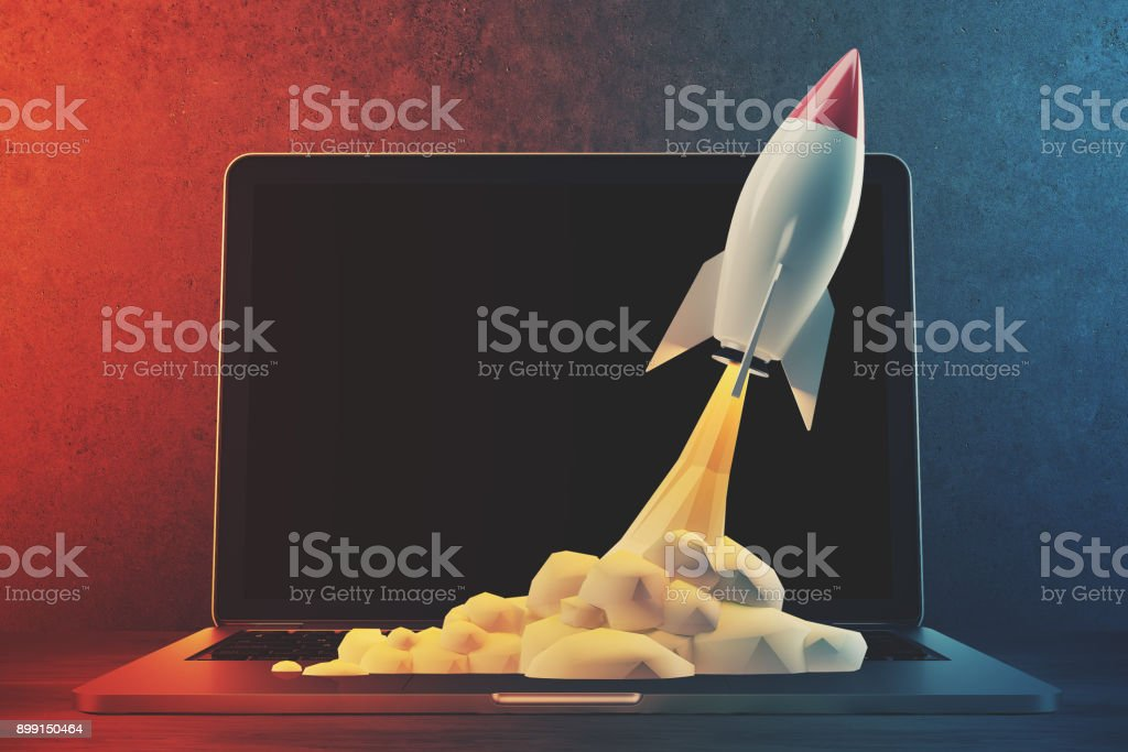 White and red rocket, laptop, space stock photo