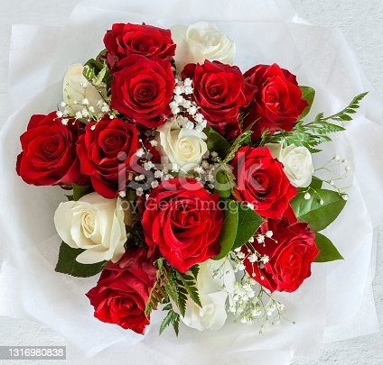 White and red rose with green leaf bouquet isolated background top view flat lay