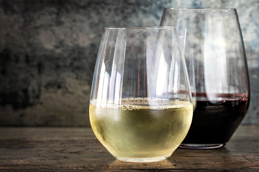 White and Red Wine in Stemless Glasses with Slate Background