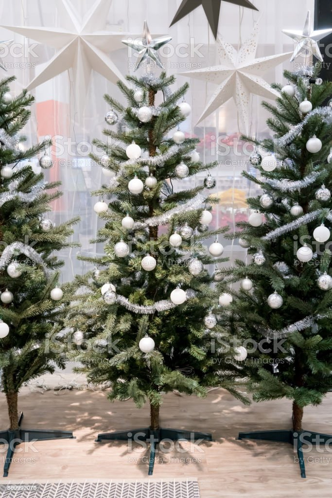 White And Silver Decorative Christmas Tree With Tinsel Garland