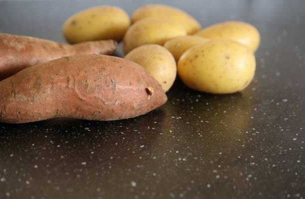 White and sweet potatoes stock photo