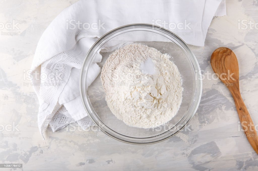 White And Whole Grained Flour With A Baking Powder In A