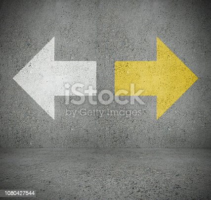 954712506istockphoto White and yellow arrow on wall, choice 1080427544
