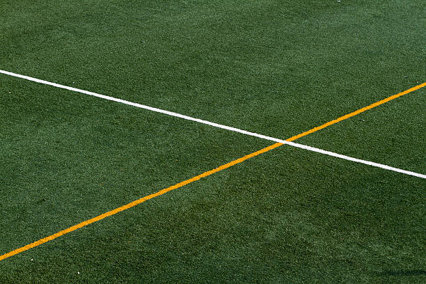 White and yellow lines at artifial grass stock photo