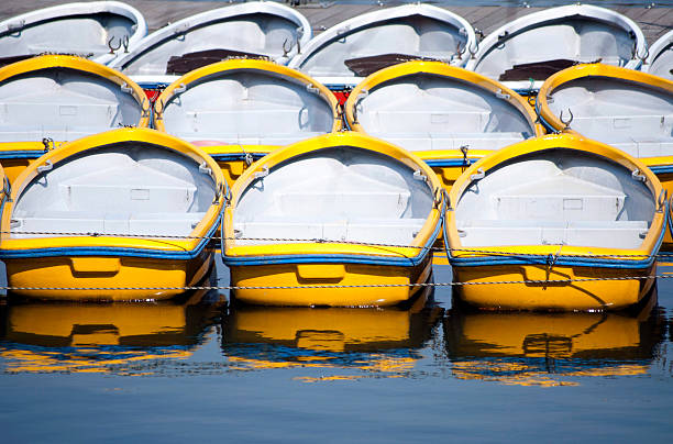 White And Yellow Row Boats